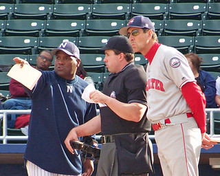Newark Bears manager Tim Raines goes over the ground rules with home plate umpire Matt Beaver and Lancaster Barnstormers manager Von Hayes before a game in 2009 (Photo credit: Paul Hadsall).