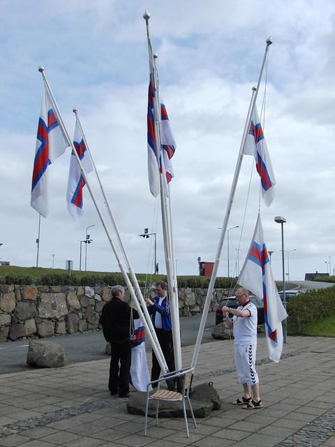 Hoisting the flags outside the Tórshavn swim pool