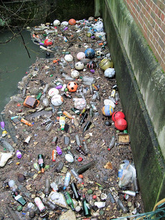 Debris and Pollution in the Duke of Northumberland's River, Kendall Bridge, Isleworth, London.