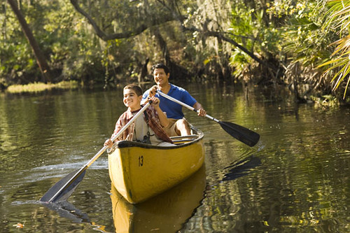 Father and Son Canoeing in lake in Kissimmee