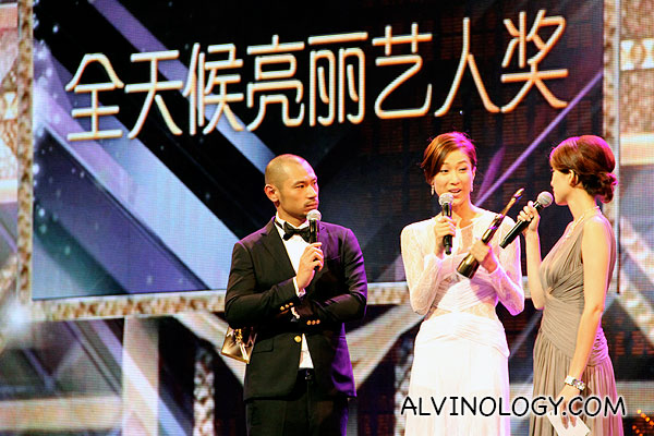 Linda Chung collecting an award on stage