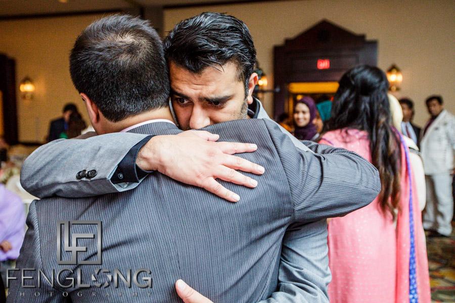 Basit and friend hug
