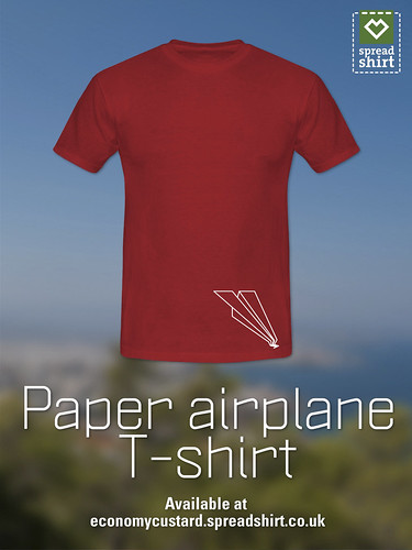 Crashed paper airplane by economy custard by Simon Sharville