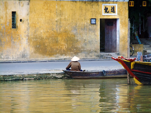 Yellow buildings along the river in Hoi An, Vietnam