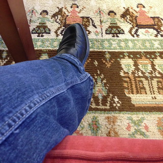 cute rug, but my feet don't reach the floor