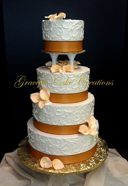 Elegant Ivory Butter Cream Wedding Cake With Champagne Colored Calla Lilys Flickr Photo