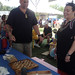 Gary (Kalehua) Krug, University of Hawaii at Manoa Assistant Specialist, educates a Smithsonian Folklife Festival visitor on Hawaiian board games.