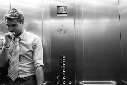 Man in lift by Fitzrovia