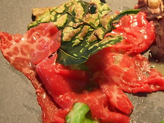 detail: Cooked and burnt cabbage, raw beef