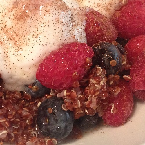 Red quinoa with berries, plain coconut yogurt, a dash of cinnamon, and a drizzle of maple syrup. So good! #plantstrong