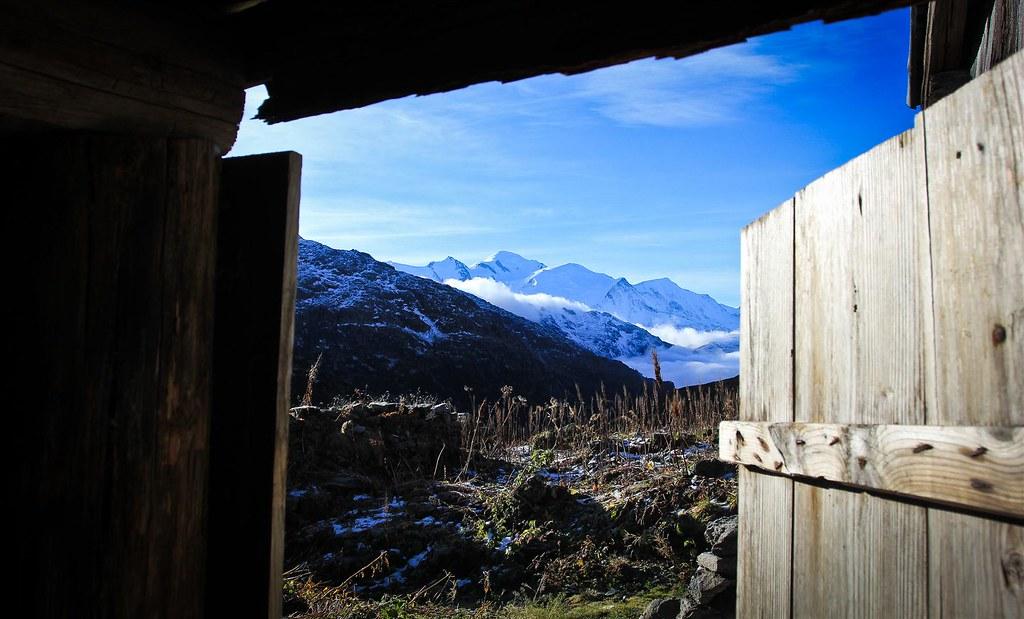 Sh*t with a view. Summit of Mont Blanc (4810m) visible from the pit toilet at Cabane de Willy. Réserve naturelle des Aguilles Rouges. Haute-Savoie. France.