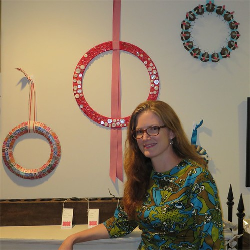 Me hanging out with my wreaths. French stamps, crystal buttons, pinecone turkey.