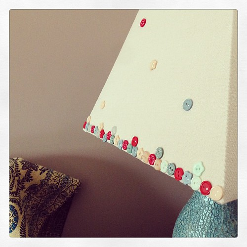 Customising the lampshades with buttons. I think I like.