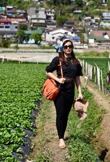 woman feeling Liza Soberano in the strawberry fields of La Trinidad