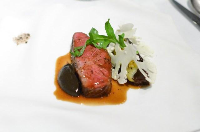 Flat Iron Steak Braised Beef Cheek, Charred Leeks, Cauliflower and Meyer Lemon