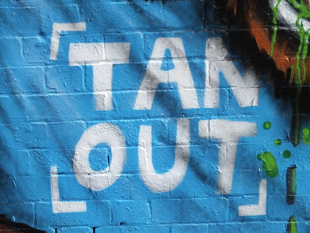 'Tan out' street art by Squid