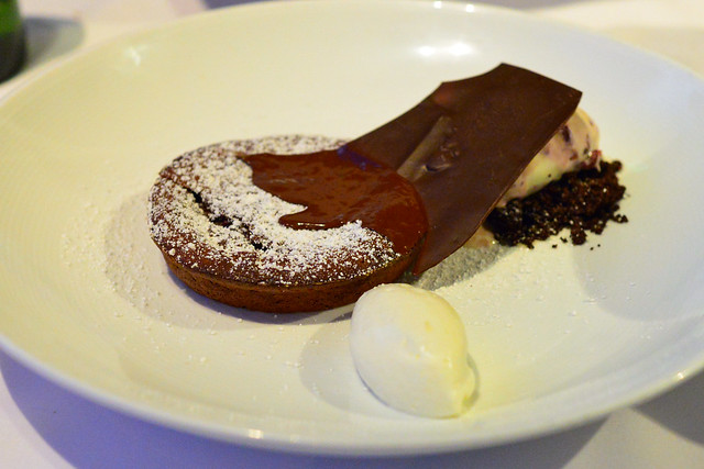 Warm Chocolate Tart, whipped crème fraiche, cocoa nib streusel, cherry ice cream