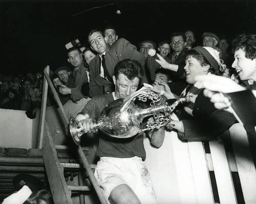 Roger Byrne carrying League Championship trophy following 1957 triumph
