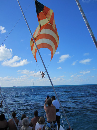 girl in bikini rides spinnaker