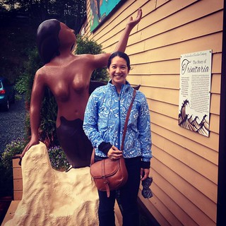 Mei with a chocolate mermaid statue outside the Newfoundland Chocolate Company.