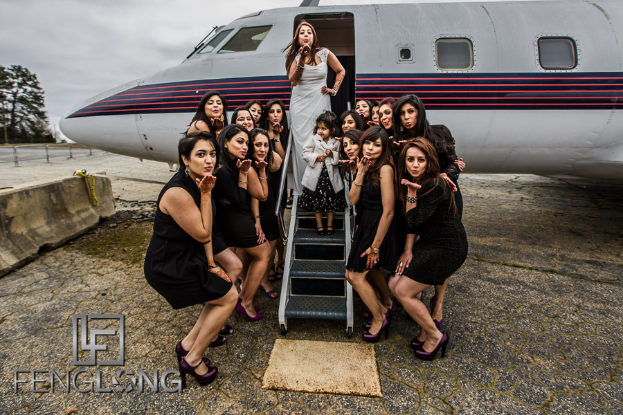 Ismaili Indian bride with bridesmaids in front of airplane for pre-wedding photos