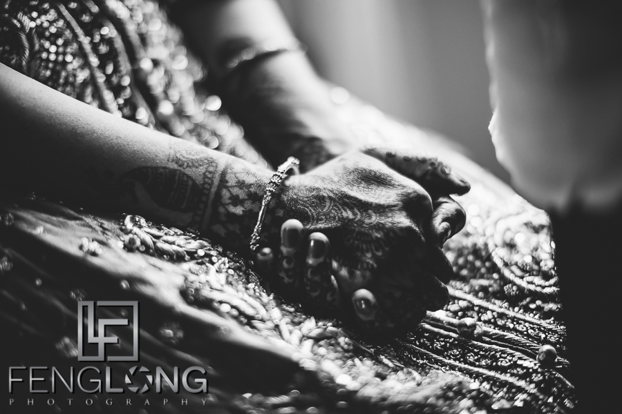 Indian bride with henna on her hands gets ready at the Ritz-Carlton Downtown Atlanta