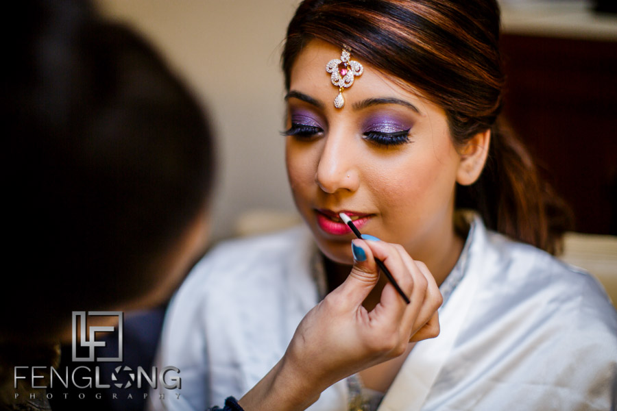 Indian bride's makeup is finalized for the reception