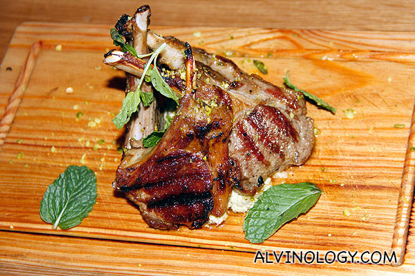 Lamp Chop Lollipops (Bone-in grilled lamb chops served with a creamy artichoke & mint sauce, roasted nuts, chilli & fresh mint) - S$29.90