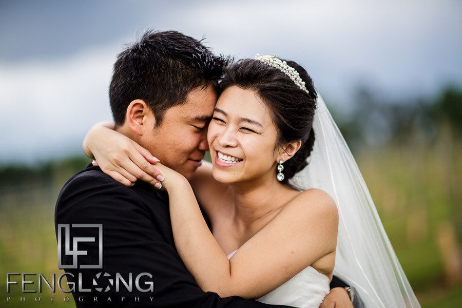 Newly wed Chinese bride and groom outdoors at Chateau Elan winery