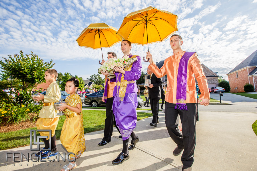 American groom and Cambodian wedding processional