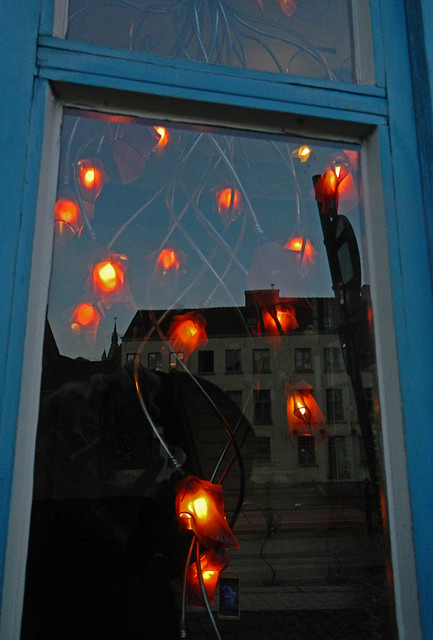 Reflection in the window of a Belgian lighting store