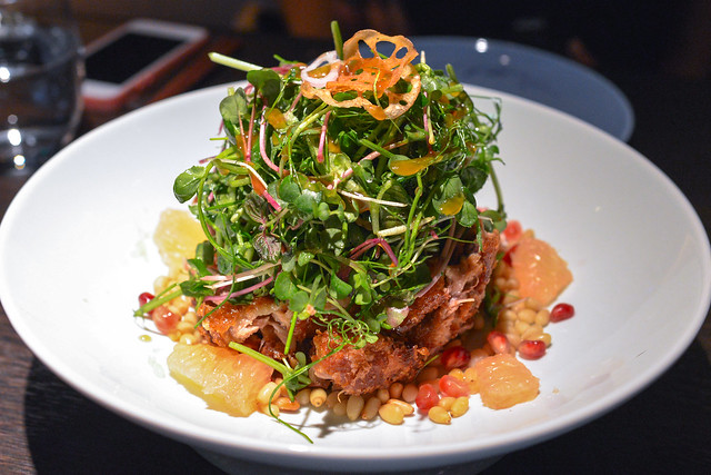 Crispy duck salad with pomegranate, pine nut and shallot