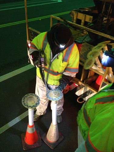 LADOT crews work to install delineators in 2nd St. tunnel