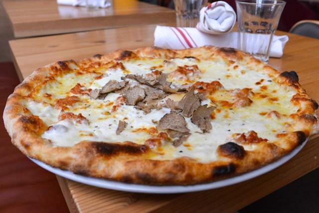 Pizza Norcina white pizza with burrata, mascarpone, fresh sausage, egg, fresh black truffles