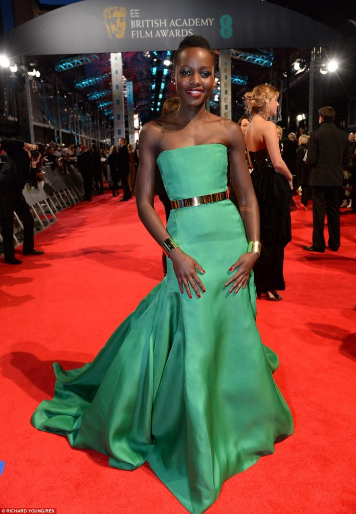 Lupita Nyong'o injects a welcome bolt of colour in emerald green silk at the 2014 BAFTAs Read more: http://www.dailymail.co.uk/tvshowbiz/article-2560711/Lupita-Nyongo-dazzles-emerald-green-silk-fishtail-hem-gown-suited-booted-Leonardo-DiCaprio-lead-glittering-A-list-attendees-2014-BAFTAs