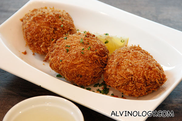 CRAB CAKES (Three potato fritters stuffed with large  chunks of crab claw meat, deep fried and served with lemon) - S$12.90