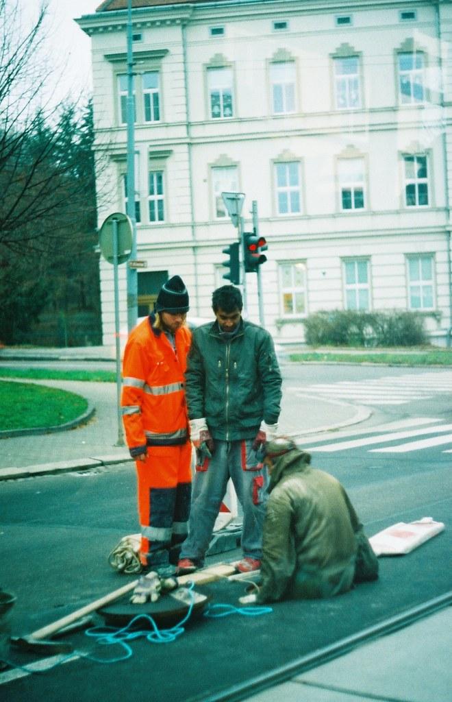 Praktica BC1 - Man Working on a Sewer (taken through colored tram window)