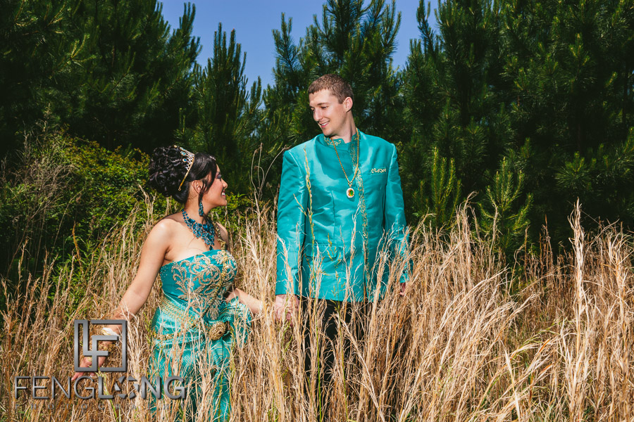 Cambodian bride and American groom take artistic portraits after Cambodian wedding ceremony