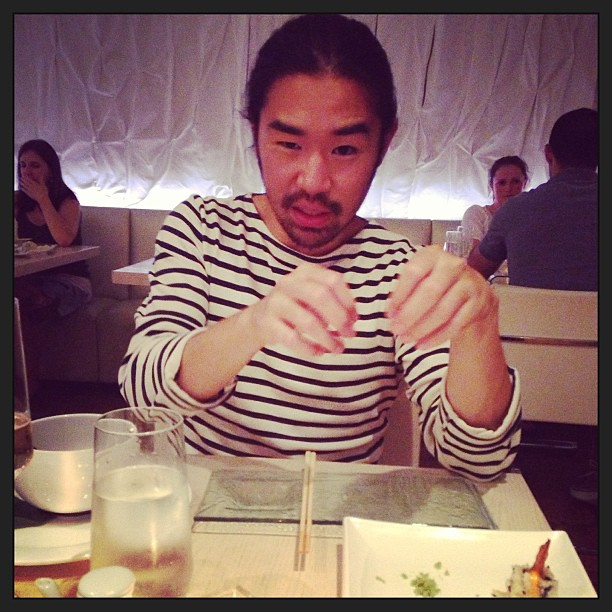 Jonathan explains Korean food at the Japanese restaurant last night. #lovehim #sushi