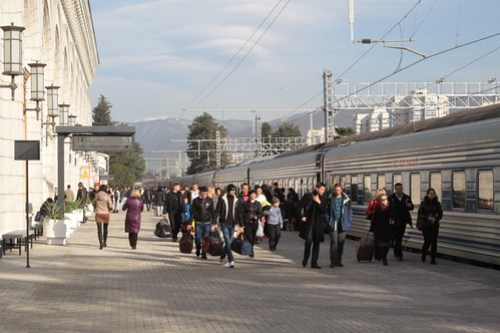 Hoards of passengers board a northbound train from Sochi