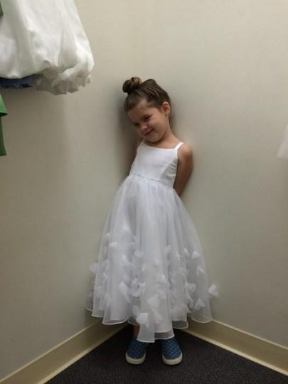 trying on flower girl dresses