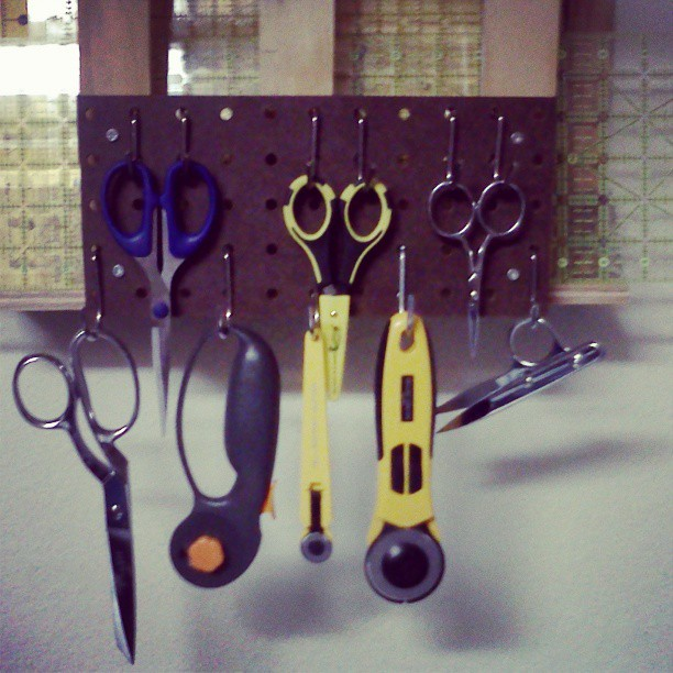 I mentioned to Mister.yesterday that a couple of hooks on the ruler rack he made me would be awesome. That way I could hang my cutter and nippers. Today he adds this. So now I have all my cutting tools available!  #heismrfixit #jackofalltrades #ilovemyhus