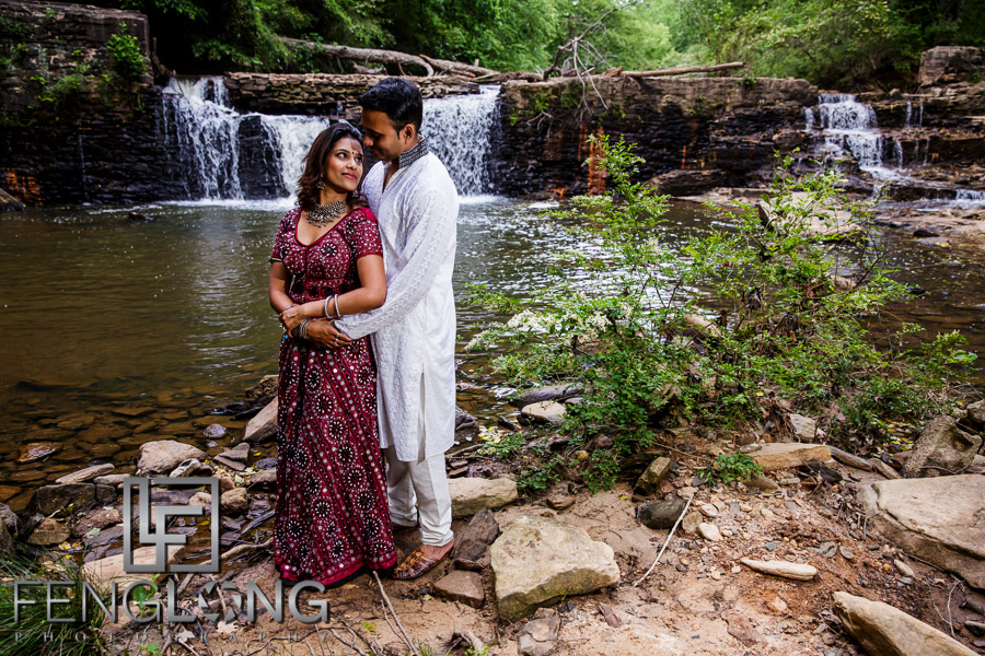 Bengali bride in Atlanta wearing a saree in front of waterfall