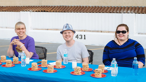 Competitors in the Cookie Love 1st Anniversary cookie eating contest, from left: Susanne Dennis, Mack Male, and Britney Le Blanc.