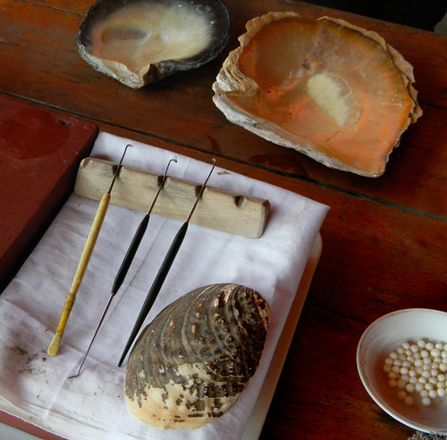 cultured pearl implements, including the round coral beads at the bottom right