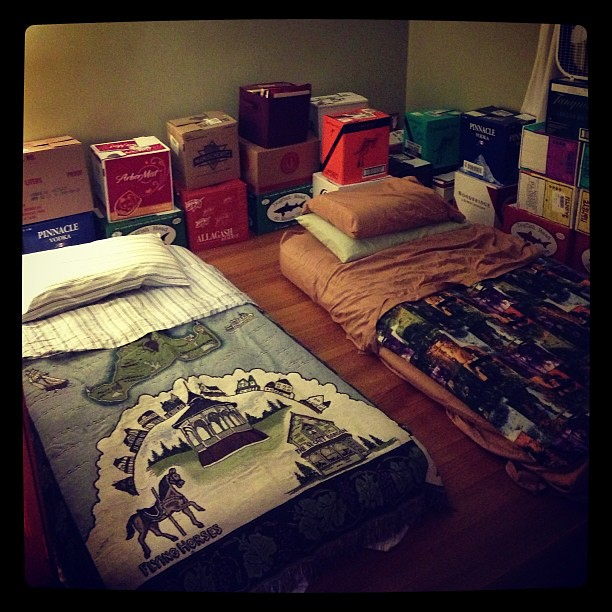 @juicedus & @ayeshamus are sleepin' in style tonight (yes, those are twin air mattresses placed in a room ringed with liquor boxes full of books. Obviously we're classy like that.)