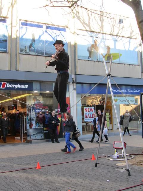 Tightrope walking violin player in Bristol