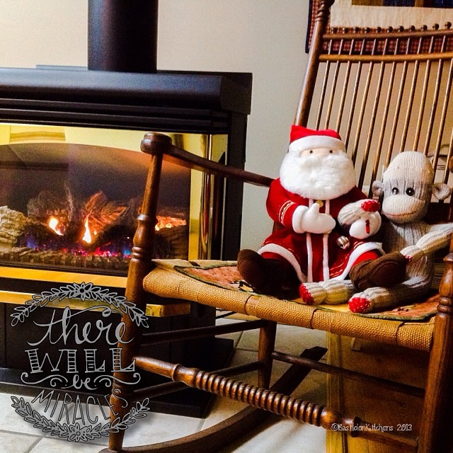 Dec 3 - warmth {Mr Sock Monkey & Santa share a quiet moment by the warmth of the fire on this damp day} #photoaday #christmas #warmth #fire #rockingchair #sockmonkey #santa #rhonnadesigns