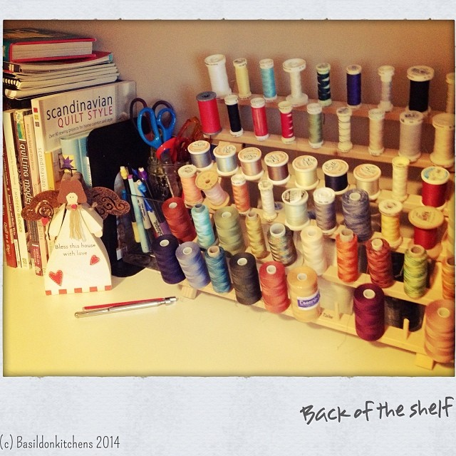 7/1/2014 - back of the shelf (in my sewing room) #photoaday #sewing #quilting #thread #scissors #books