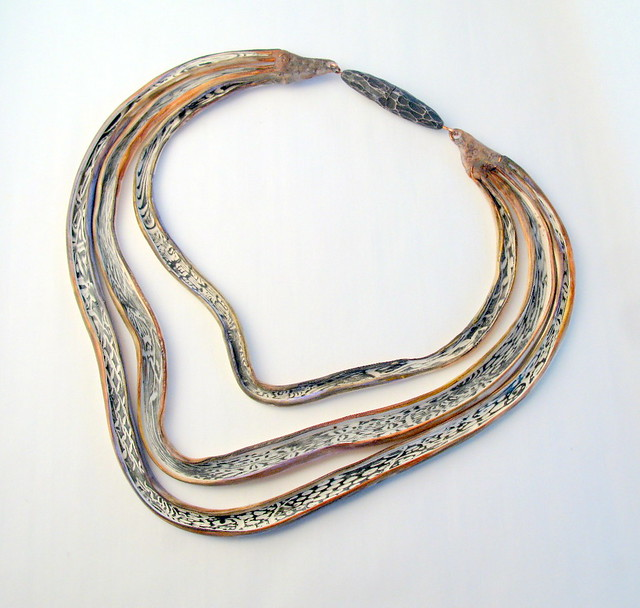 'Snakeskin' tube necklace with carved closure